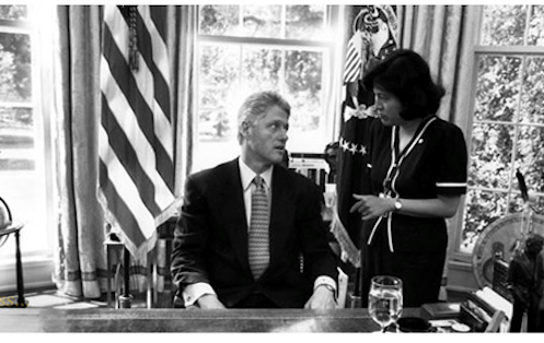 Dr. Connie Mariano working with President Bill Clinton
